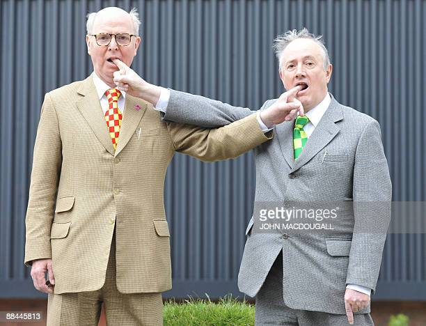 Londonbased artists Gilbert and George pose for photographers outside the Arndt and Partners gallery in Berlin on June 12 prior to a press conference...