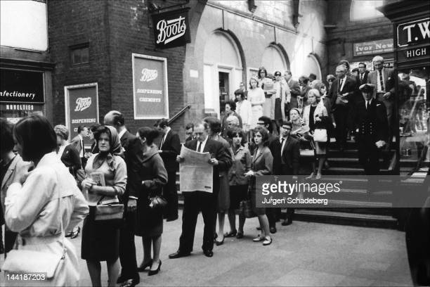 Londoners queuing at Oxford Circus tube station during rush hour London 1964