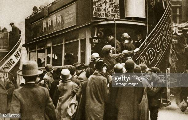 Londoners rushing for a bus on Ludgate Hill c1920s The first motorised London buses began operating in 1902