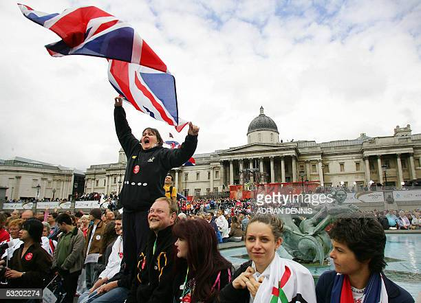 Londoners show support for the London bid for the 2012 Olympic Games before the announcement in London's Trafalgar Square 06 July 2005 London erupted...