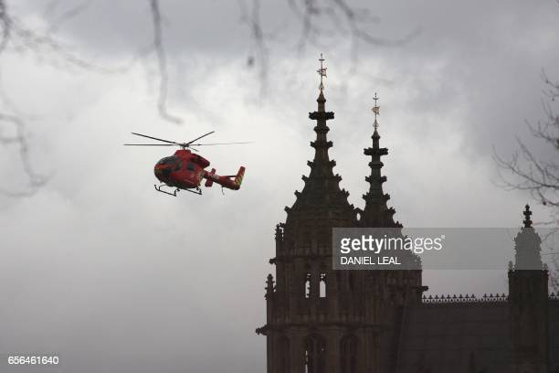 London's air ambulance arrives at the Houses of Parliament in central London on March 22 2017 during an emergency incident Britain's Houses of...