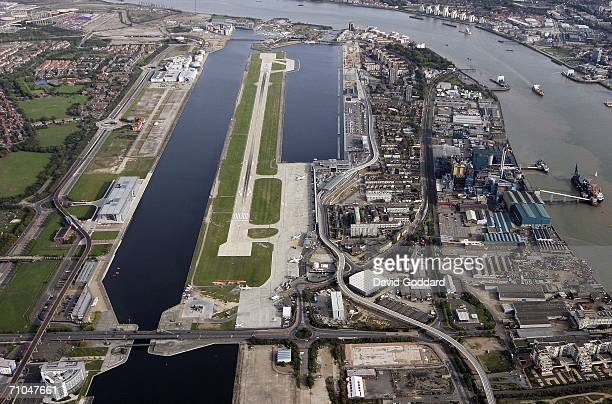 London's disused docks surround the runway at London's City Airport in this aerial photo taken on October 9 2005 above London England City airport...