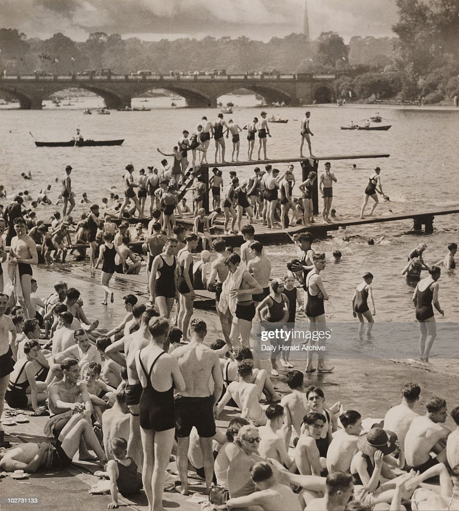 London's famous open spaces, 21 Jun 1937. 'Londons open spaces are being fully appreciated just now by her citizens, who flock to them every moment they can spare. A typical scence at the Sepentine Lido.