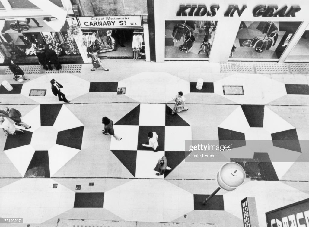 London's fashionable Carnaby Street with its new multicoloured rubber paving tiles, 1973.