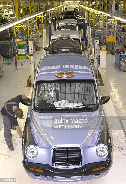 STORY 'London's legendary back cab steps out in the world' A man works on a TX11 model taxi at London Taxis International premises in Coventry 24...