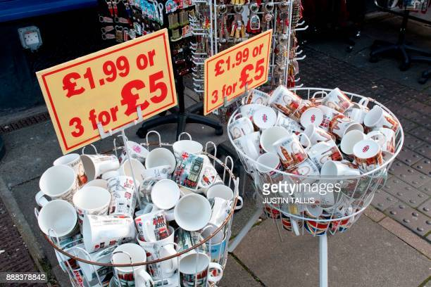 Londonthemed souvenir mugs are pictured for sale outside a gift shop in Windsor west of London on December 8 2017 Britain's Prince Harry will marry...