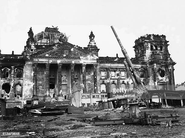 A lone abandoned artillery gun in front of the Reichstag building in Berlin