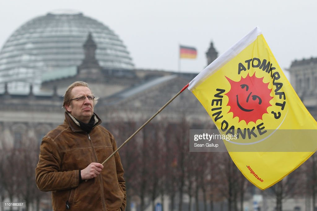 A lone anti-nuclear activist holds vigil in front of the Chancellery near the Reichtsag while holding a banner that reads: 'Nuclear Power? No Thanks!' on March 16, 2011 in Berlin, Germany. German Chancellor Angela Merkel announced the day before that Germany will suspend operation of all seven of its nuclear power plants built before 1980 pending a heightened security and safety review. Merkel's policy shift comes in reaction to the current dramatic situation at the stricken Fukushima reactor in Japan, though many anti-nuclear activists remain dissatisfied and demand and are demanding an immediate halt to nuclear energy in Germany.