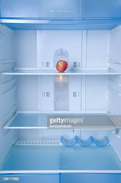 Lone Apple Sitting in Empty Refrigerator