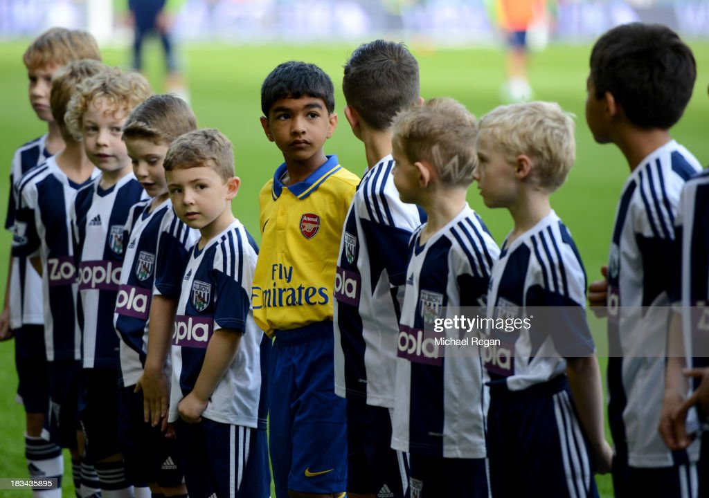 A lone Arsenal mascot lines up with West Bromwich Albion mascots prior to the Barclays Premier League match between West Bromwich Albion and Arsenal at The Hawthorns on October 6, 2013 in West Bromwich, England.