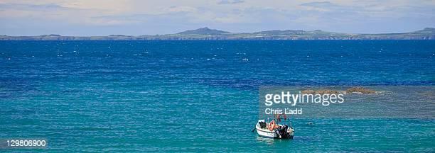 Lone boat in St Brides Haven St Brides Bay Pembrokeshire Coast National Park Pembrokeshire Wales