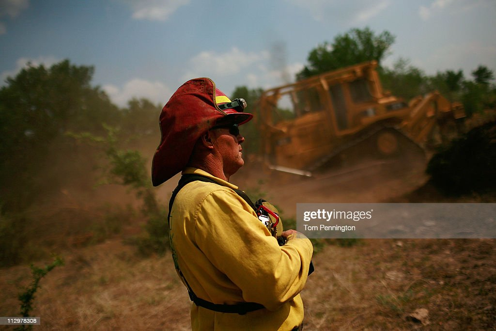 Lone Camp assistant fire chief Brandon Thornburg supervises the construction of a 66-foot wide fire containment line on April 22, 2011 in Strawn, Texas. Fire crews are using heavy machinery to help contain the PK Complex Fire that has destroyed more than 160 homes in the area.