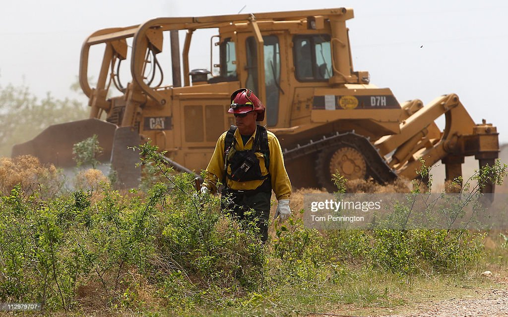 Lone Camp assistant fire chief Brandon Thornburg surveys the construction of a 66-foot wide fire containment line on April 22, 2011 in Strawn, Texas. Fire crews are using heavy machinery to help contain the PK Complex Fire that has destroyed more than 160 homes in the area.