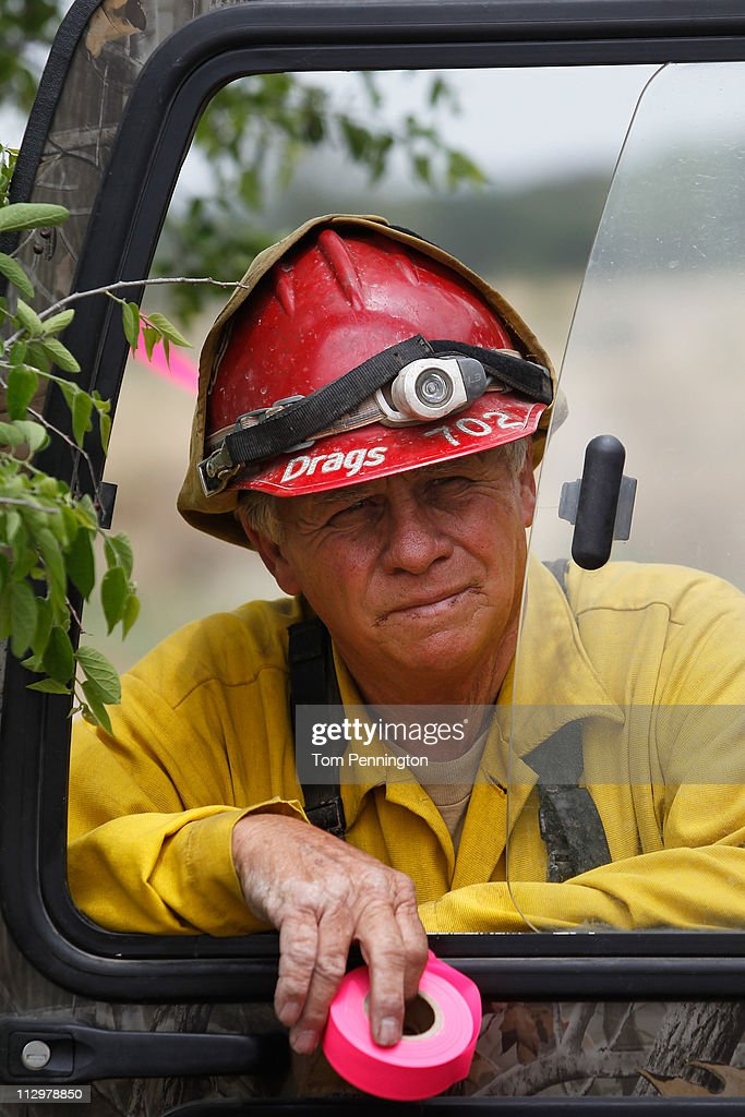 Lone Camp fire chief Charlie Sims takes a break while surveying the construction of a 66-foot wide fire containment line on April 22, 2011 in Strawn, Texas. Fire crews are using heavy machinery to help contain the PK Complex Fire that has destroyed more than 160 homes in the area.