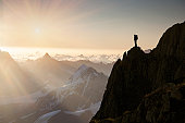 Lone climber on top of a peak