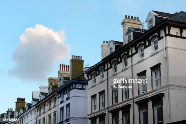 Lone cloud over Victorian houses, Folkestone, England