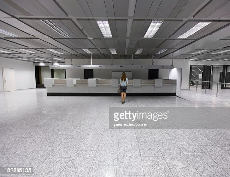 Lone customer in a large empty terminal