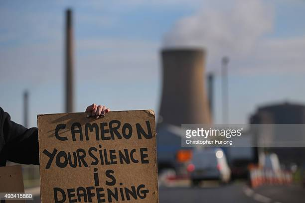 Lone demonstrator Neil Dawson protests in support of the UK steel industry outside the Tata Steel processing plant at Scunthorpe after Tata announced...