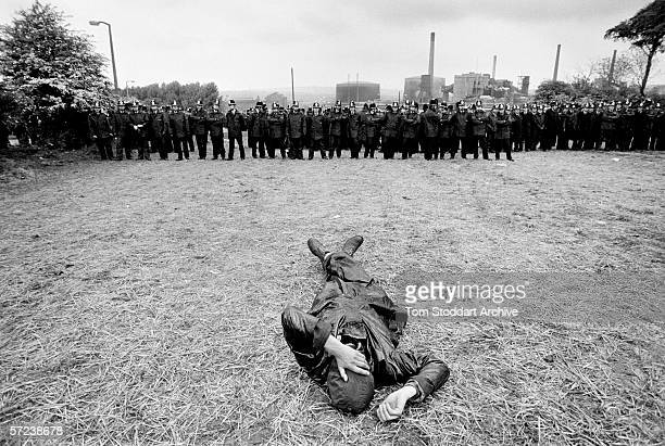 A lone demonstrator rests as police form lines to protect a coking plant at Orgreave near Sheffield The 'Battle of Orgreave' when up to 5000 miners...