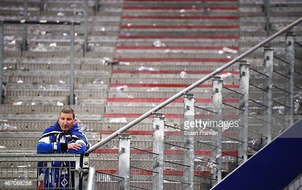 A lone fan of Hamburg is lost in thought after the Bundesliga match between Hamburger SV and Hertha BSC at Imtech Arena on March 20 2015 in Hamburg...