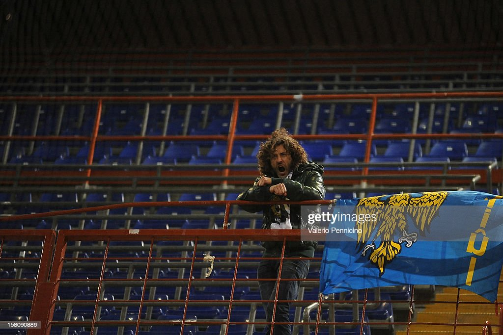 A lone fan of Udinese Calcio looks on during the Serie A match between UC Sampdoria and Udinese Calcio at Stadio Luigi Ferraris on December 10, 2012 in Genoa, Italy.