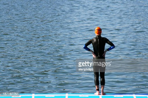Lone female swimmer standing at the waters edge