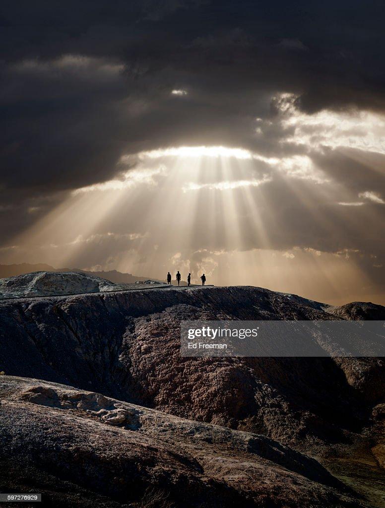 Lone Figures, Mountain, Dramatic Sky : Stock Photo
