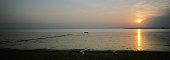 A lone fishing boat anchored in the waters of the Tapajos river at the village of Jaguarari at sunset The Floresta Nacional do Tapajos a 6500 km2...