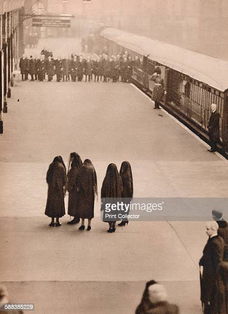 Queen Mary with the Princess Royal and her daughtersinlaw after the departure of the coffin waiting at King's Cross to drive to Buckingham Palace'...