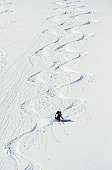 Lone heli-skier making S curves, Coast Range, Canada, elevated view