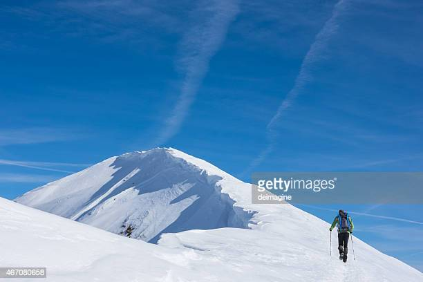 Lone hiker on top of mountain