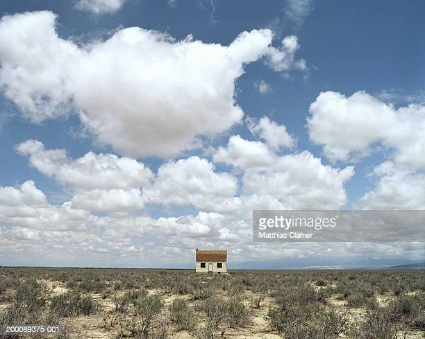 Lone house in desert field