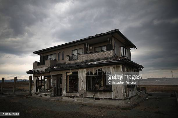 A lone house sits on the scarred landscape inside the exclusion zone close to the devastated Fukushima Daiichi Nuclear Power Plant on February 26...
