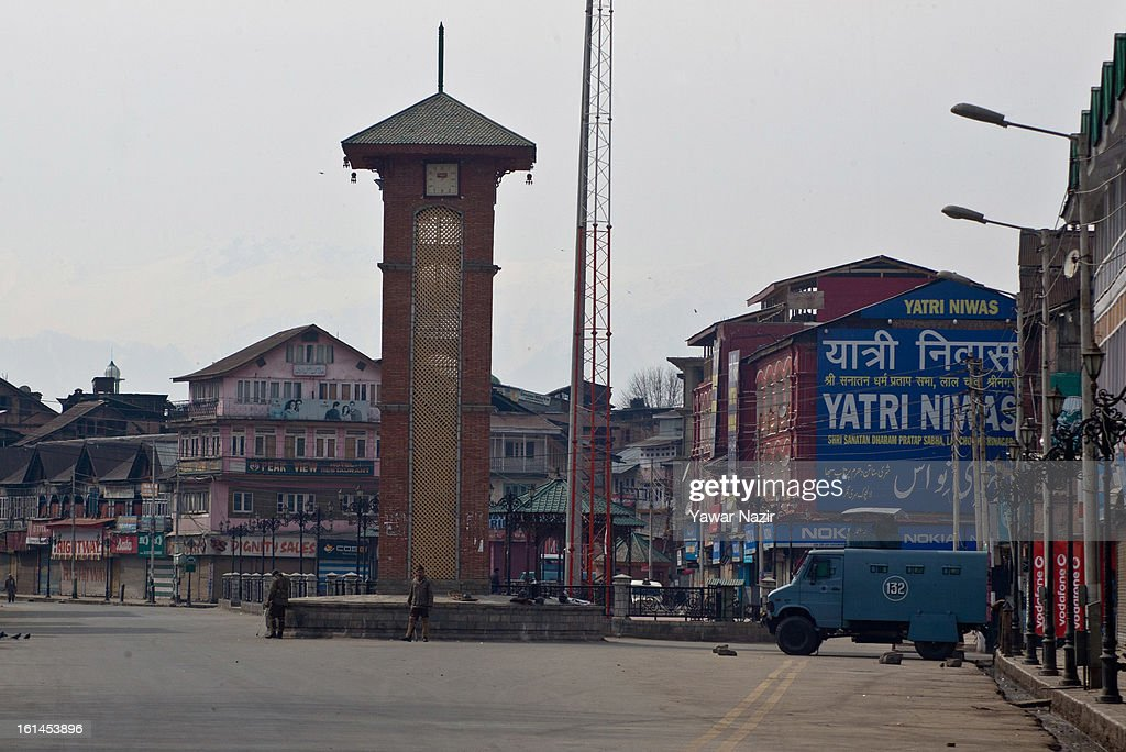 A lone Indian paramilitary vehicle is parked in Lal Chowk during a curfew, imposed after the execution of alleged Indian parliament attacker Mohammad Afzal Guru on February 11, 2013 in Srinagar, the summer capital of Indian Administered Kashmir, India. Afzal Guru, from Sopore town in the north of Kashmir, was hung on February 09 for his role in the 2001 Indian parliament attack which left 14 dead. The hanging has further strained relations between India - who blamed the attack on 'Pakistan backed' militant group Jaish-e-Mohammed - and neighbouring Pakistan and has seen an military increase from both along the border.
