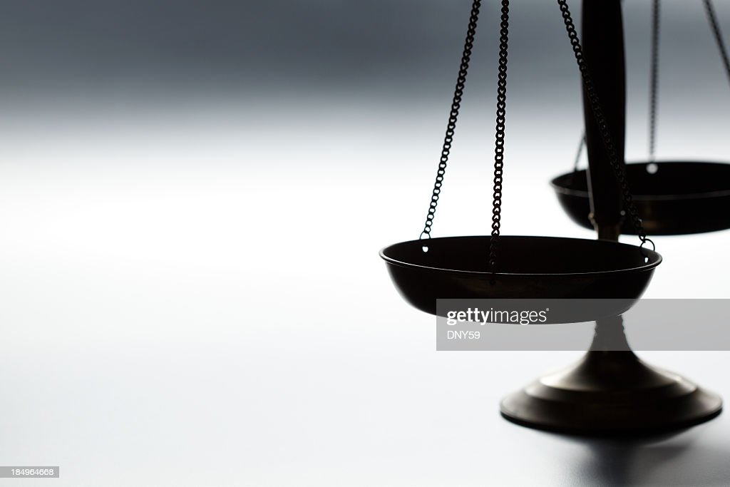 Lone justice scale on simple gray background : Stock Photo