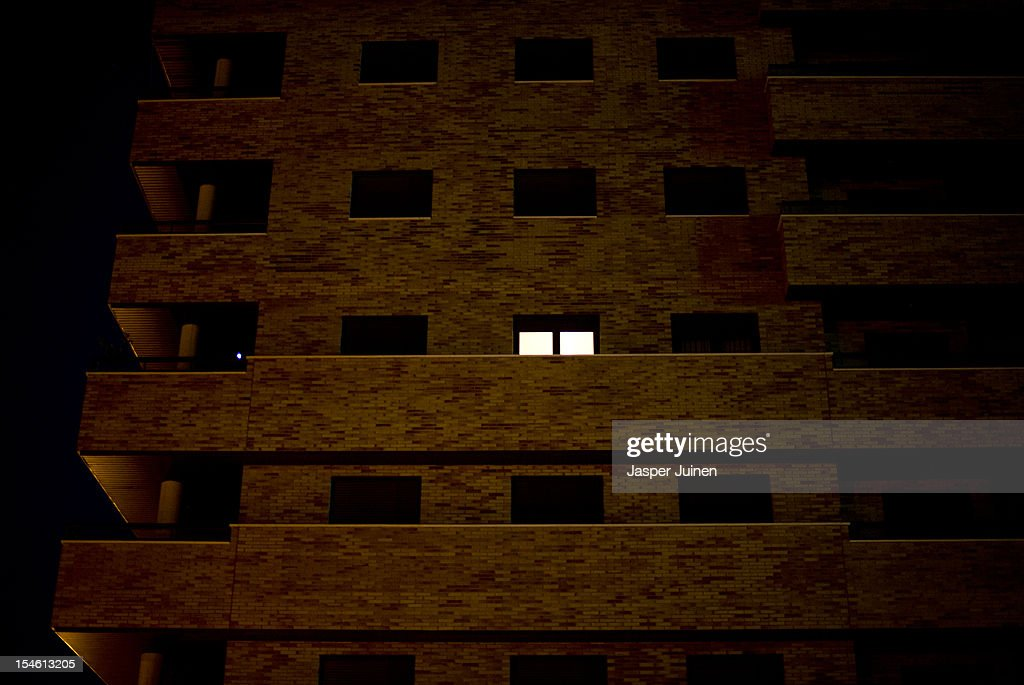 A lone light burns in a apartment in between others with their exterior window shutters closed on October 22, 2012 in Sesena, Spain. With a housing backlog of more than 1.2 million unsold newly build homes, banks in Spain have recenlty started to sell their real estate assets with discounts, some upto 80 percent, slashing prices to a level not seen for over 20 years. With morgages of 100 percent, some experts worry that mistakes from the past are repeated again.