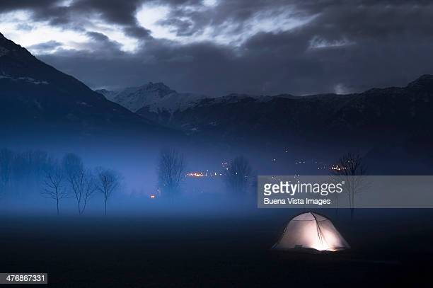 Lone lit tent in the night