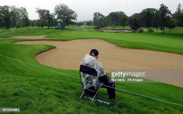 A lone marshall keeps watch over an empty green as todyas practice round has been left in doubt due to adverse weather conditions at the K Club Co...