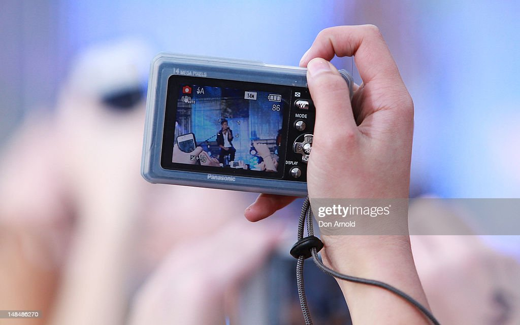 A lone mobile phone camera is shown against a sea of phone cameras as Justin Bieber performs live on the Sunrise program at The Overseas Passenger Terminal on July 18, 2012 in Sydney, Australia.