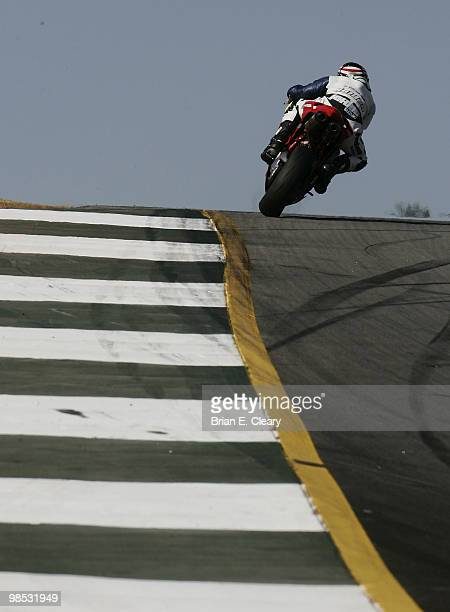 A lone motorcycle races over a hill during the AMA Superbike Showdown at Road Atlanta on April 18 2010 in Braselton Georgia
