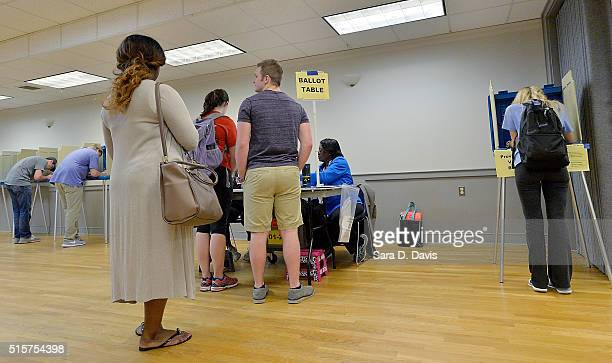 A lone North Carolina State University student right votes in the primaries at the provisional ballot booth at Pullen Community Center on March 15...