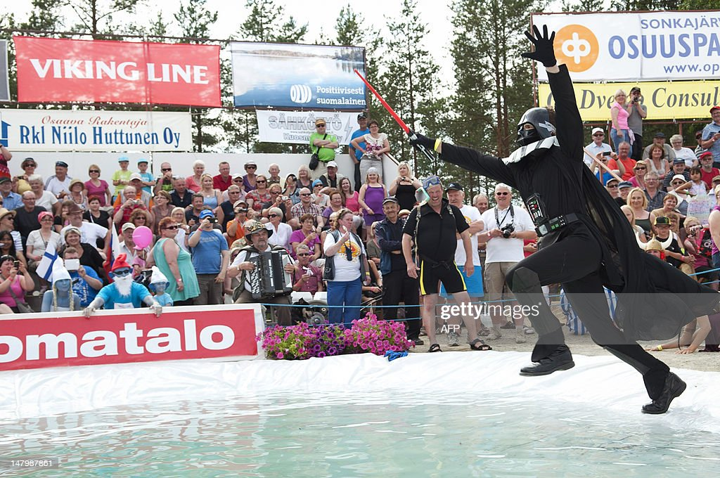 A lone participant dressed as Darth Vader takes part in the Wife Carrying World Championship competition in Sonkajarvi, on July 7, 2012. The pair won first-place in the competition. AFP PHOTO / LEHTIKUVA / Timo Hartikainen