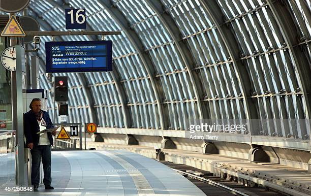 A lone passenger waits at the central station in Berlin as train employees strike on October 15 2014 in Berlin Germany Train drivers from the...