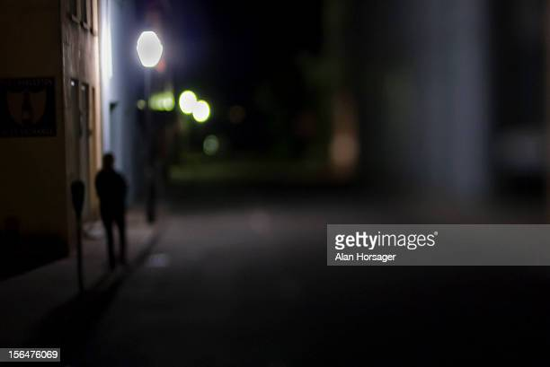 Lone person on a night stroll