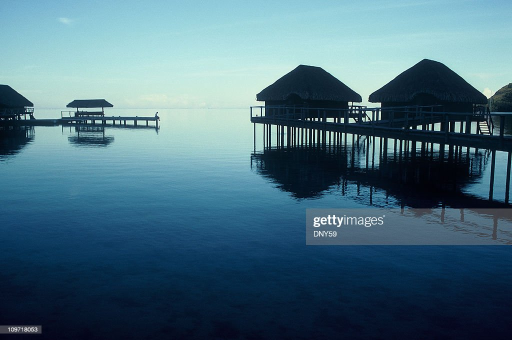 Lone Person Standing on Pier in Tropical Resort : Stock Photo