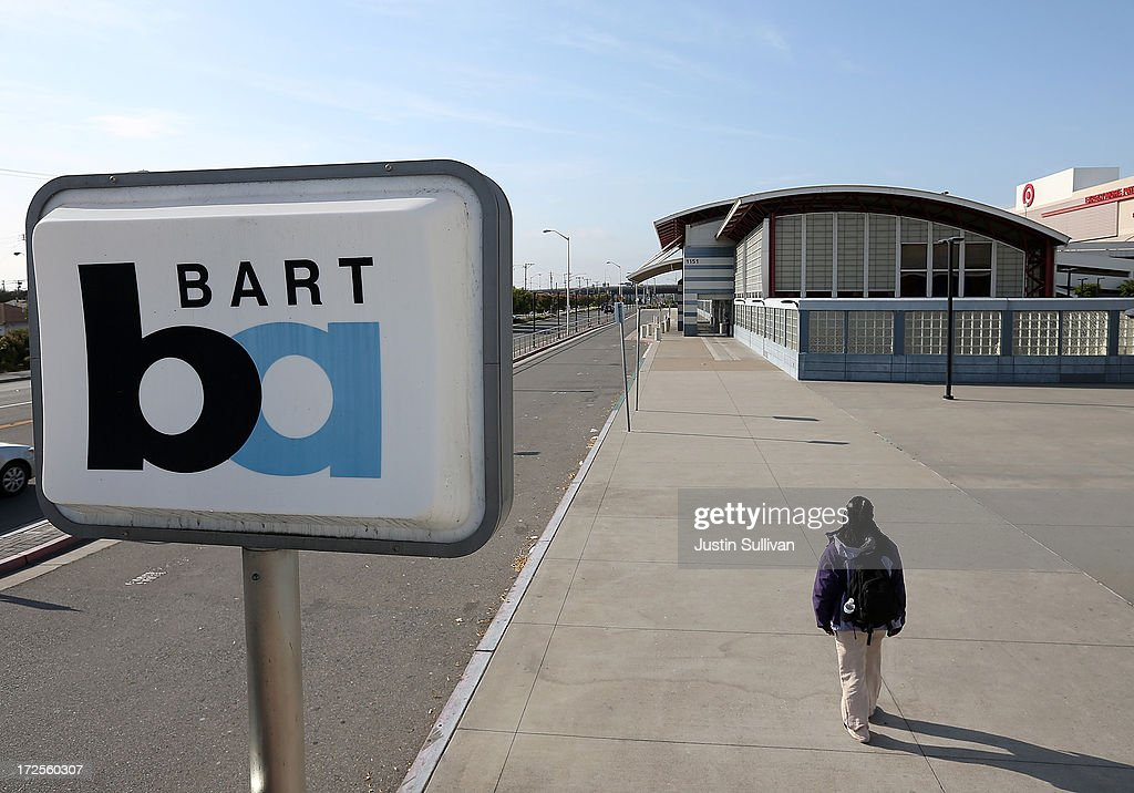 A lone person walks through an empty Bay Area Rapid Transit (BART) station on July 3, 2013 in San Bruno, California. For a third day, hundreds of thousands of San Francisco Bay Area commuters are scrambling to find ways to work as two of San Francisco Bay Area Rapid Transit's (BART) largest unions remain on strike while they continue contract negotiations with management. Train operators, mechanics, station agents and maintenance workers are seeking a five percent wage increase and are fighting management who want to have workers to begin contributing to their pensions, pay more for health insurance and reduce overtime expenses.