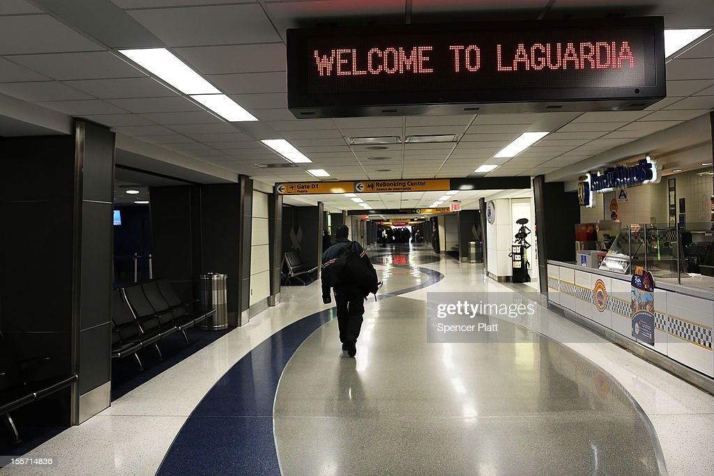 A lone person walks through an empty LaGuardia Airport on November 7, 2012 in New York City. The Northeast suffered another storm today as a mix of snow, rain and high winds moved through the area, canceling flights and creating hazardous driving conditions. Six thousand households in the area are still without power for more than nine days following Superstorm Sandy.