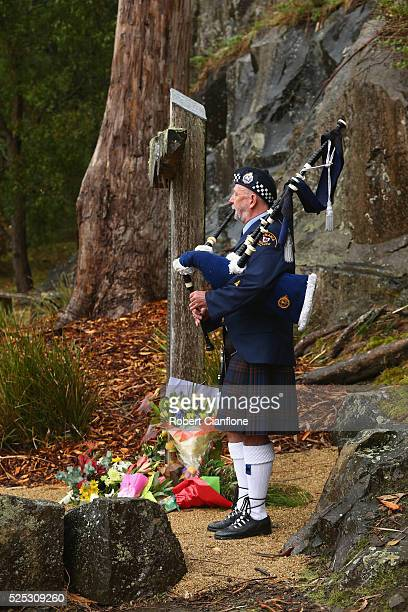 Lone piper James McAlpine performs during the 20th anniversary commemoration service of the Port Arthur massacre on April 28 2016 in Port Arthur...