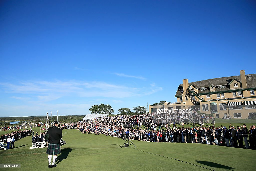 A lone piper plays from the middle of the 18th fairway at the start of the Opening Ceremony as a preview for the 2013 Walker Cup Match at National Golf Links of America on September 6, 2013 in Southampton, New York.