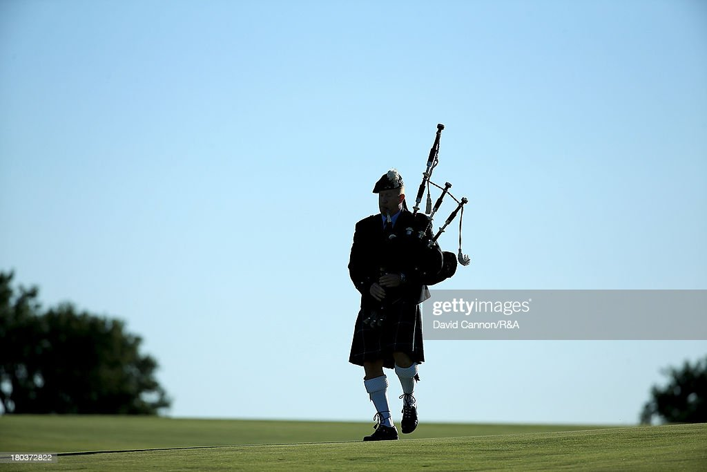A lone piper walks down the 18th fairway at the start of the Opening Ceremony as a preview for the 2013 Walker Cup Match at National Golf Links of America on September 6, 2013 in Southampton, New York.
